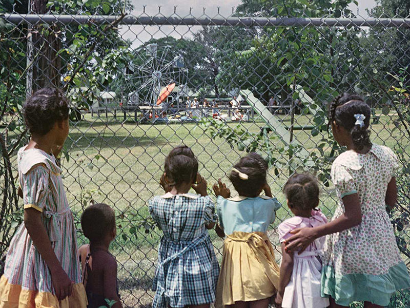 """A photograph by Gordon Parks, """"Outside Looking In, Mobile, Alabama, 1956."""""""